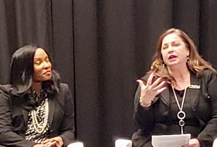 NFL's Jocelyn Moore listens to CREW Network's Wendy Mann during a panel on diversity at ICSC RECon Las Vegas.