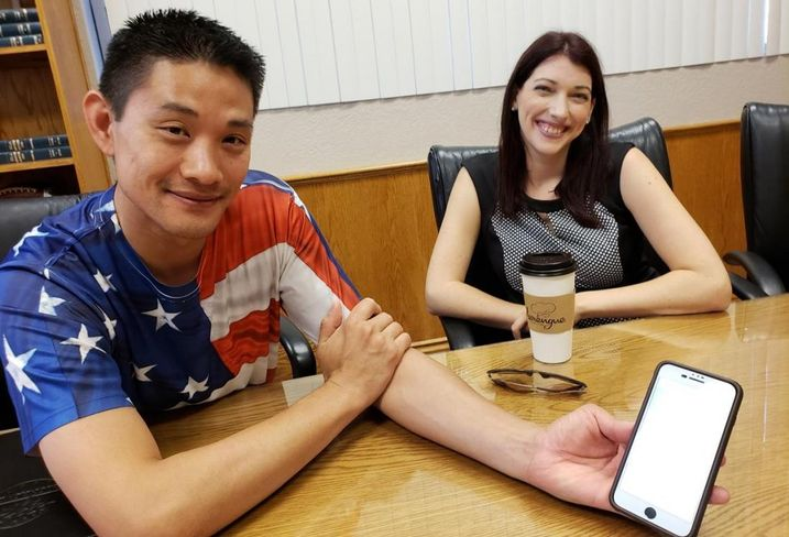 Monrovia City Manager Oliver Chi and Assistant City Manager Brittany Mello show how to use the GoMonrovia program on the Lyft app July 3, 2018 at Monrovia City Hall.