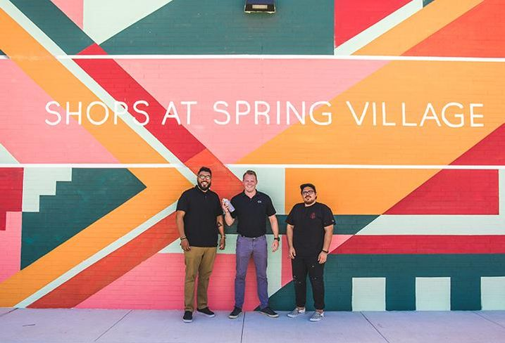 Artist A.J. Rose, Capital Retail Properties co-founder Anderson Smith and artist David Maldonado posing in front of their newly completed mural at the Shops at Spring Village in Spring, Texas.