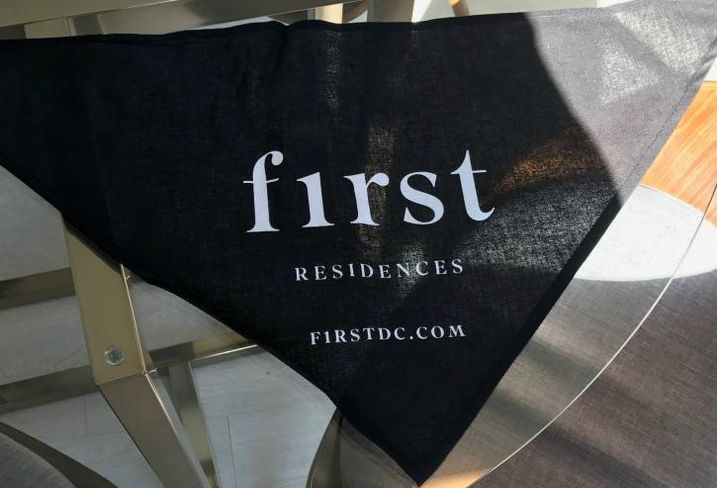 McCaffery Interests gave away dog bandannas promoting F1RST, its Washington, D.C. apartment development, at All Things Go Festival.