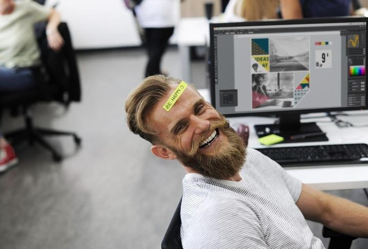 Happy office worker computer smile