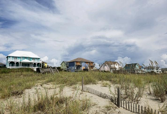 At Emerald Isle, some houses were boarded up while others were not.