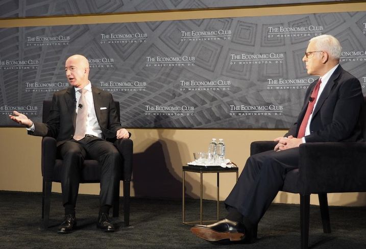 Amazon CEO Jeff Bezos and Carlyle Group CEO David Rubenstein