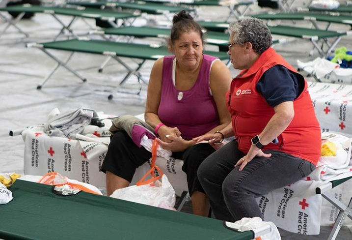 All across the eastern seaboard, luxury and budget hotels, school gymnasiums and campgrounds became makeshift homes for Hurricane Florence evacuees this week. Above, Rosa Arce is comforted by American Red Cross Regional Communications Officer Jerri Jameson on Friday in Charlotte.