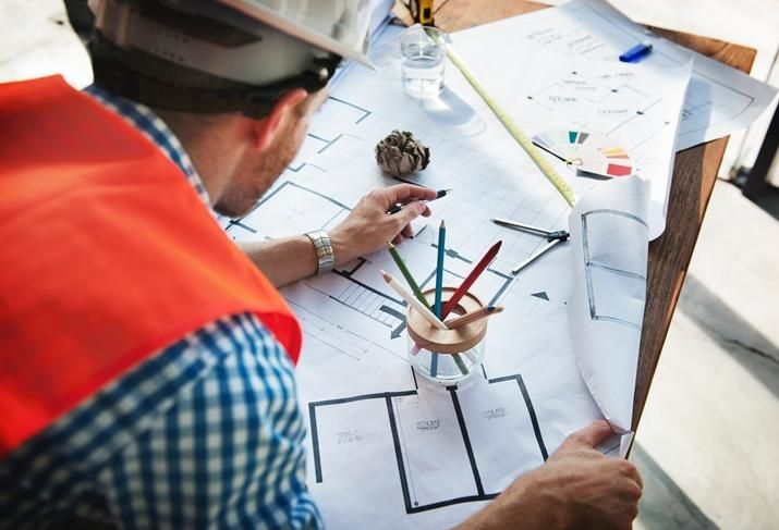 Construction blueprints worker
