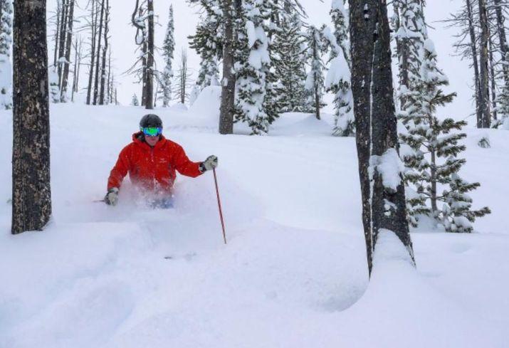 Bob Courteau skiing in Calgary during a heli-ski trip