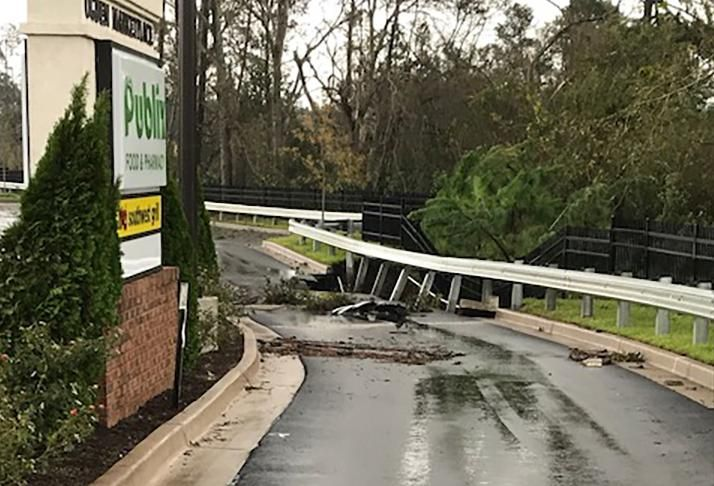Ogden Market Place in Wilmington sustained downed trees, power outage and damage to the parking lot and signage.