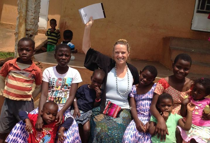 Kennedy Wilson Property Services' Christine Deschaine volunteers with Bringing Hope to the Family in Uganda.