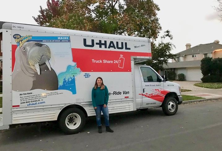 Jenifer Levy, an Orange County resident, poses in front of the U-Haul she filled up with donations to take to Camp Fire victims.