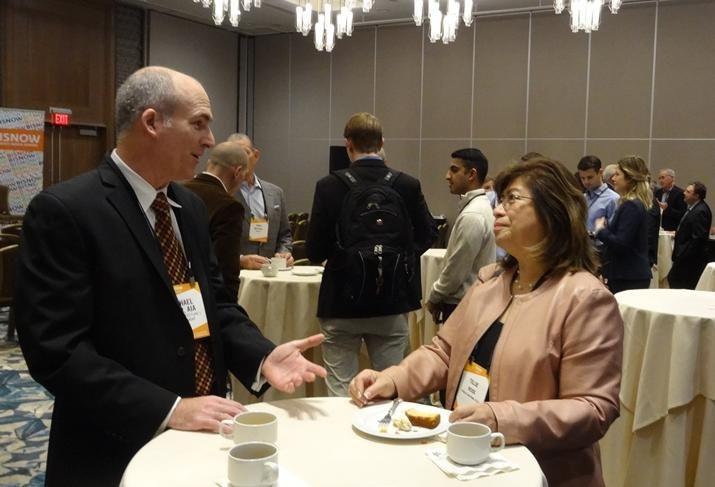 Attendees network at Bay Area Capital Markets and Real Estate Finance