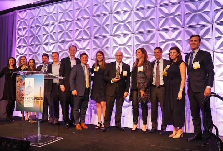 The JBG Smith team accepting the Deal of the Decade award for landing Amazon HQ2