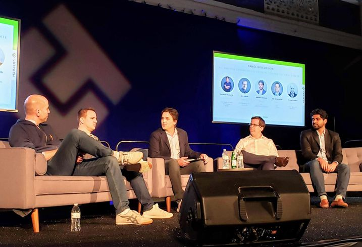 Reonomy co-founder and CEO Richard Sarkis, Cherre CEO L.D. Salmanson, Savills Chief Information Officer, Head of Client Technology Patrick McGrath, Skyline AI co-founder and CEO Guy Zipori and Leverton Corp. CEO Abhinav Somani speak during a panel at the CRE Tech event in Los Angeles.