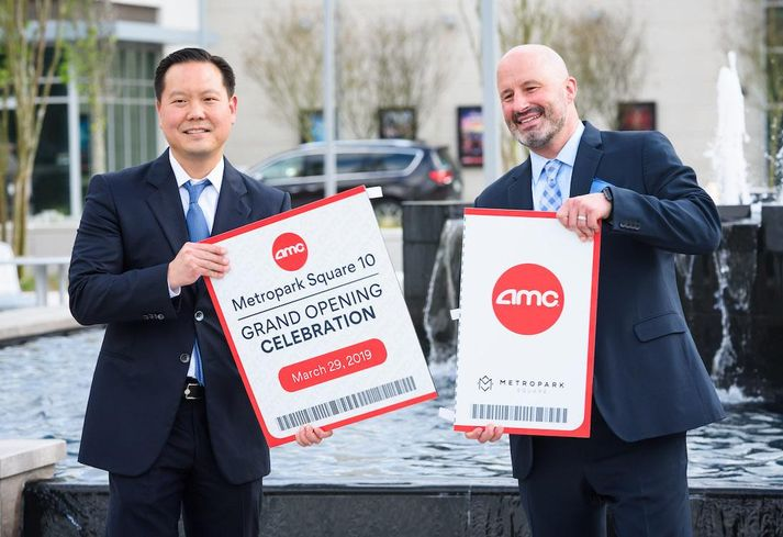 Sam Moon Group Vice President and general counsel Daniel Moon and Vice President of Construction Shane Williams celebrate the grand opening of the AMC Metropark Square 10.