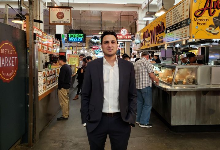Langdon Street Capital Principal Adam Daneshgar stands in the middle of the Grand Central Market in downtown Los Angeles.