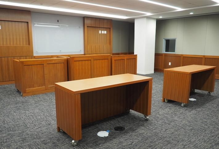 A mock courtroom in the DOJ's Constitution Square 4 office