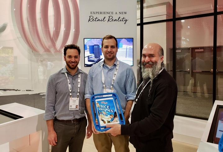 Thyng CEO Ed La Hood (right) with his team demonstrating augmented reality at the JLL booth at ICSC RECon in Las Vegas.