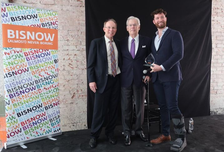 MATT Construction Chairman and CEO Steve Matt, Rising Realty Partners Chairman Nelson Rising and Bisnow's West Coast Director Michael Guimond at Bisnow's Los Angeles State of the Market at the Trust Building in downtown Los Angeles. Rising received Bisnow's lifetime achievement award, the Bizzy.