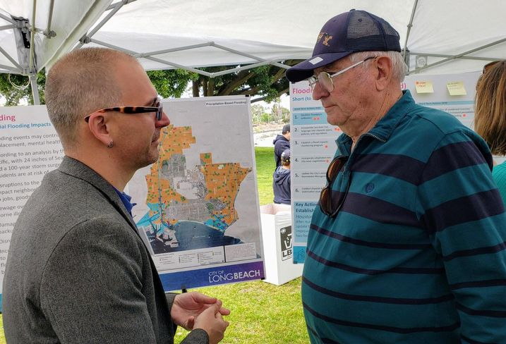 Long Beach Development Services Planning Bureau Manager Christopher Koontz (left) speaks to a concerned resident about climate change during the city of Long Beach climate fest.