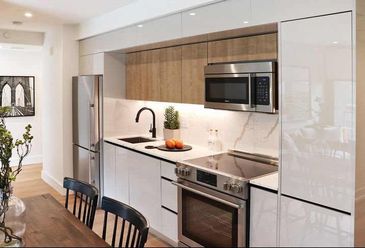 A kitchen at the Piazza in Philadelphia, all finishes and materials provided by Mega Supply Pro