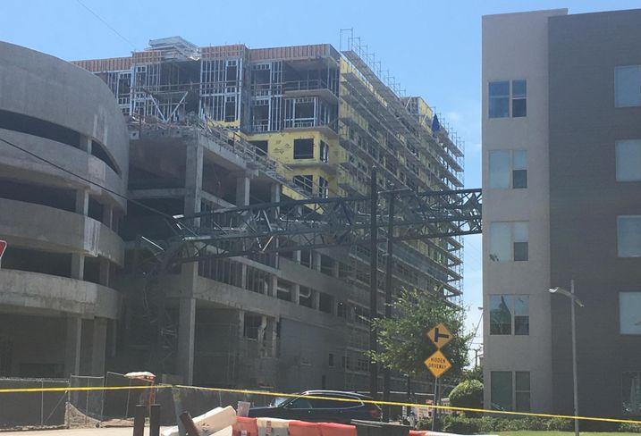 Apartment Building Struck By Falling Crane Is Uninhabitable, Plaintiffs Ask Court To Block Crane's Removal