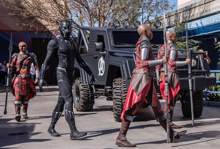 The king of Wakanda, Black Panther, and his royal guards walk to a meet-and-greet area at the Hollywood Backlot area of Disney California Adventure park in Anaheim.