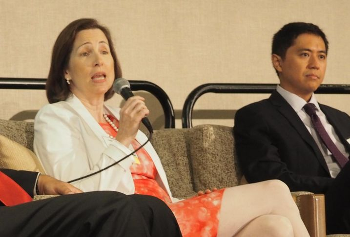 Nina Janopaul speaking at a 2015 Bisnow event