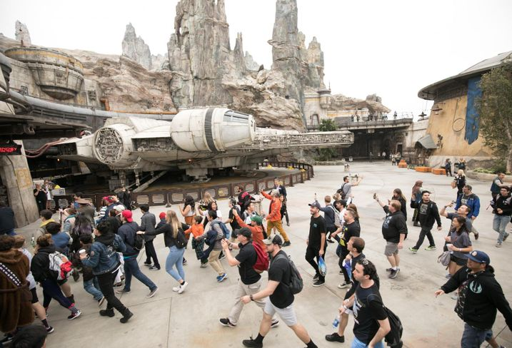 Visitors rush to ride the Millennium Falcon: Smugglers Run ride at Galaxy's Edge in Disneyland in Anaheim.