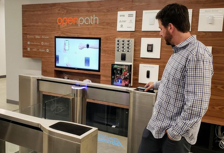 No more keycards. Openpath co-founder James Segil demonstrates how his phone allows him access through an automated entrance control gate.