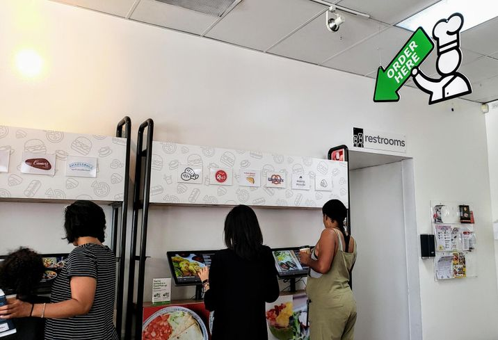 Visitors order inside Kitchen United's store, Eats on Madison, in Pasadena