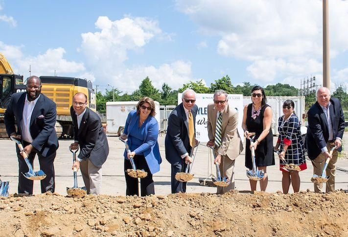Stonebridge executives and local officials at the Carlyle Crossing groundbreaking