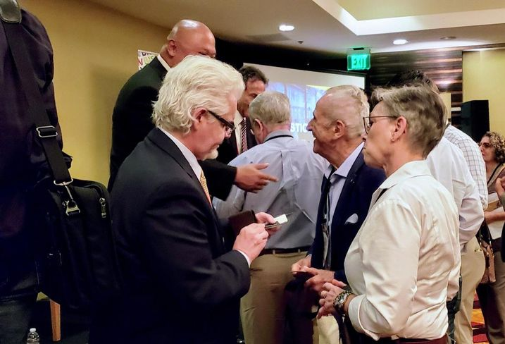 Attendees network after a panel at Bisnow's LA Opportunity Zones event held at The LA Grand Hotel Downtown.