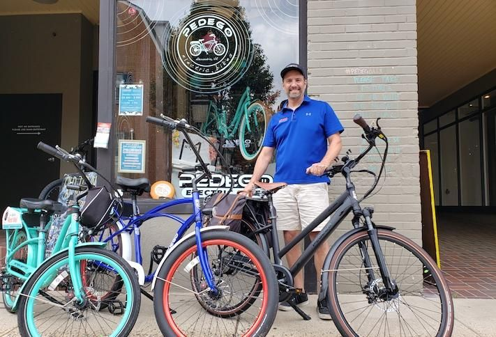 Todd Ketch, the owner of Pedego Electric Bikes' Alexandria location, in front of his Old Town store