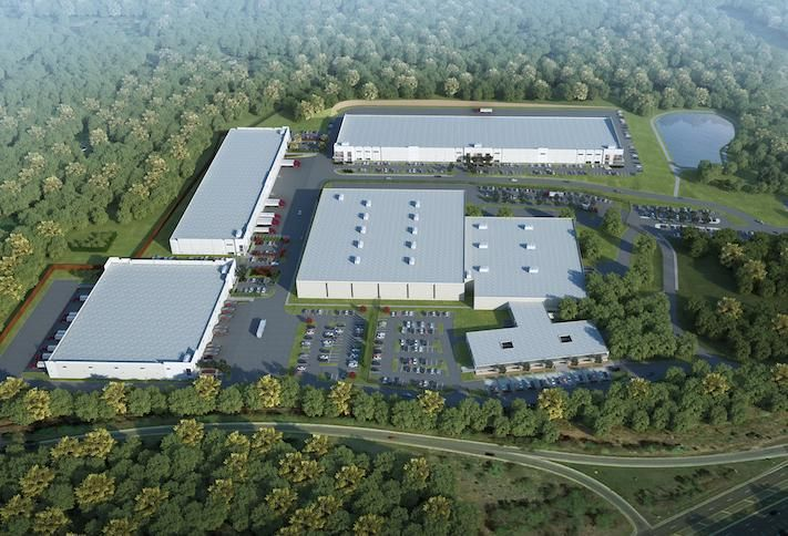 A rendering of the Hargrove Industrial Campus, with the three new buildings around the edge of the existing warehouse
