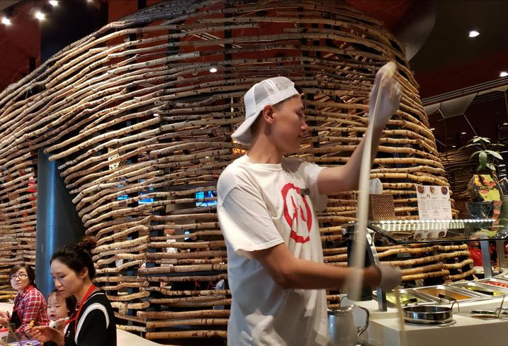 A noodle dancer performs at HiDiLao Hot Pot at the Westfield Santa Anita mall in Arcadia