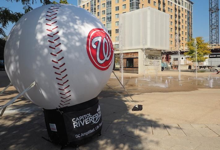 A Nationals baseball pop up in Canal Park, with the Wiseguy Pizza in the background