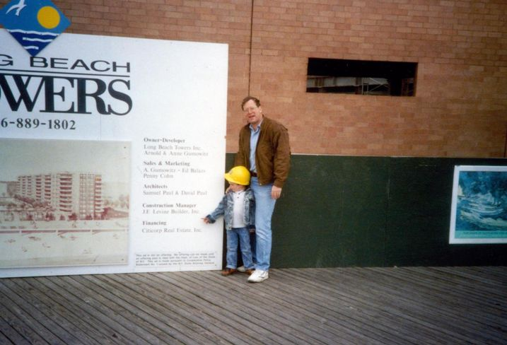 Douglaston founder Jeff Levine and his son, Ben, in the 1980s