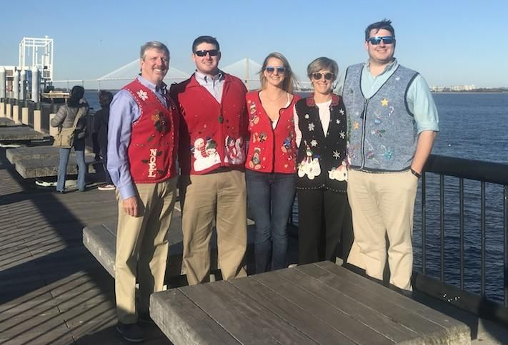 Jefferson Apartment Group CEO Jim Butz with his family in Christmas sweaters