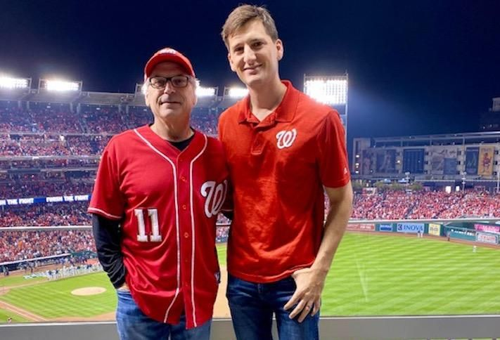 Melnick Real Estate Advisors' Jesse Mates (right) at World Series Game 3 with his father