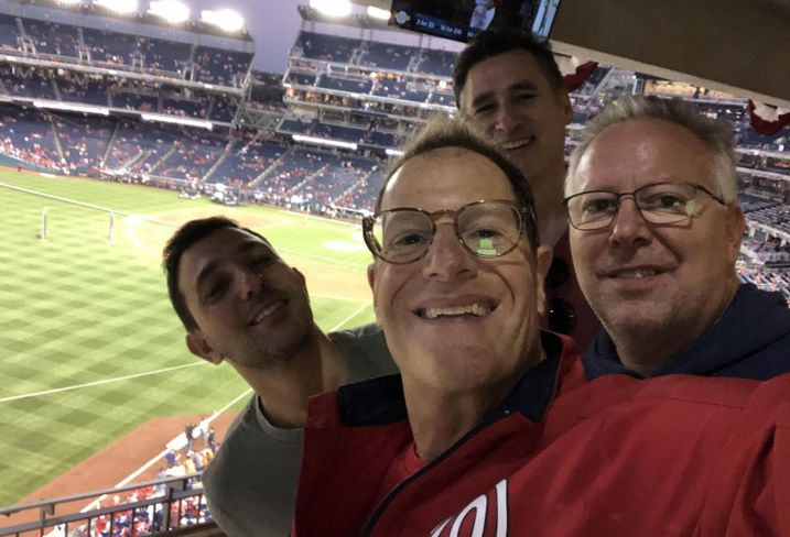 CohnReznick Managing Partner David Kessler poses with CohnReznick's Adam Goodman and MTAG Services' Adam Berman and Jim Meeks at the World Series.