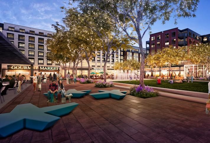 A rendering of the central plaza in the Parks at Walter Reed development, with the grocery store on the left