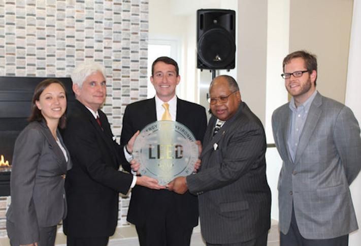 Fore Property Co.'s Jim Sullivan (center) accepting a LEED certification plaque