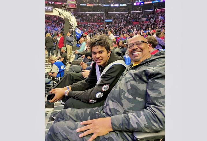 Avanath Capital's Daryl Carter with his son Nathan at a Clippers game.