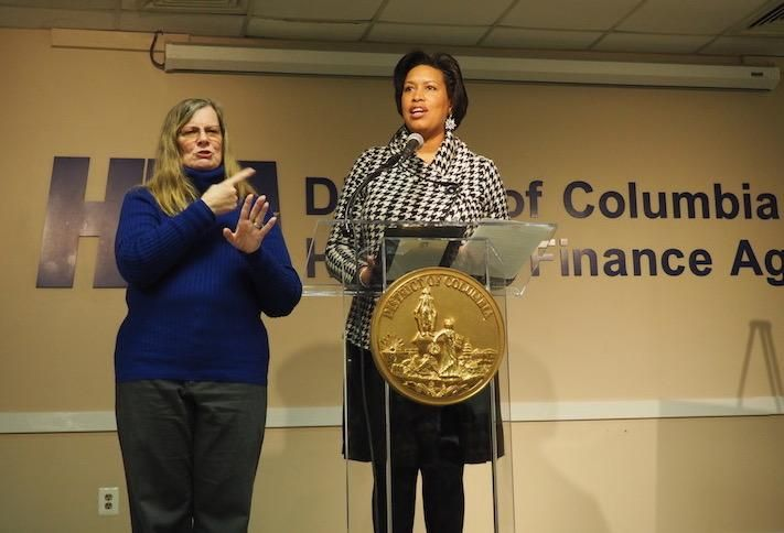 Mayor Muriel Bowser speaking at the New Year New Housing event Jan. 17, with a sign language interpreter on the left.