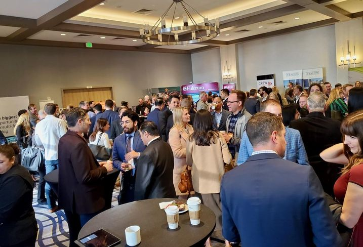 Attendees network at Bisnow's Orange County Construction and Development event at the Irvine Marriott hotel in Irvine