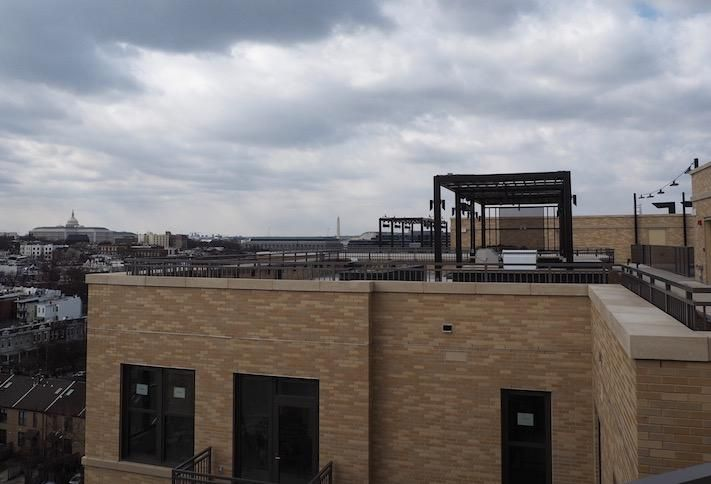 The rooftop courtyard and view of the U.S. Capitol atop the Avec building on H Street.