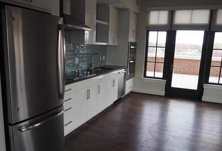 The kitchen and door to the private terrace in a fifth-floor two-bedroom unit in the Avec building.