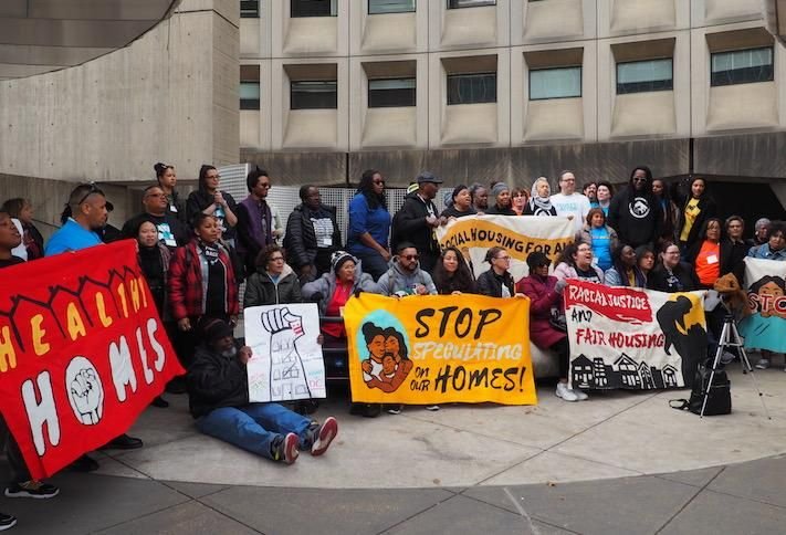 Housing advocates protesting outside the HUD headquarters.