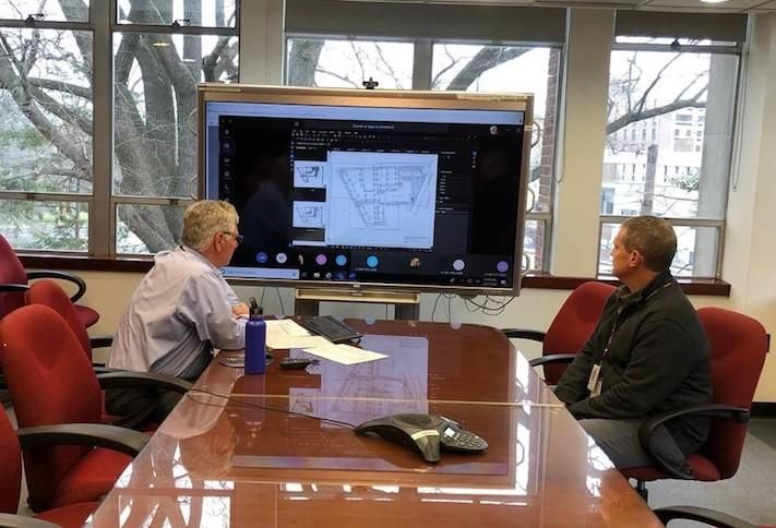 Montgomery Planning Chief of Development Review and Regulatory Coordination Mark Pfefferle and Deputy Director Robert Kronenberg conducting a committee meeting through a video conference.