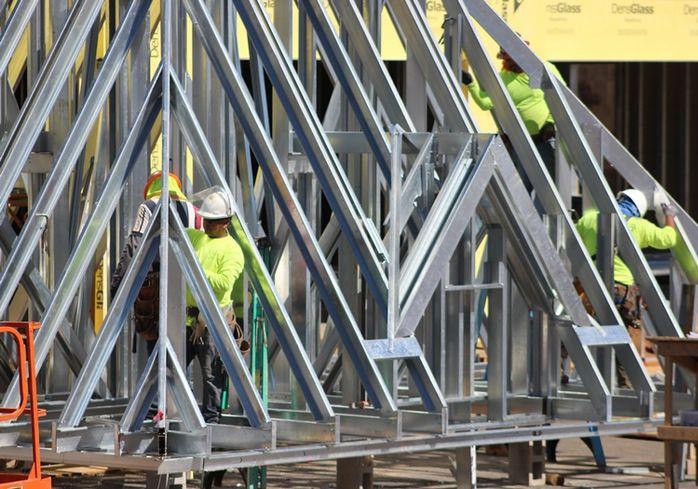 Construction continues in suburban Atlanta development despite the coronavirus pandemic, March 25, 2020.