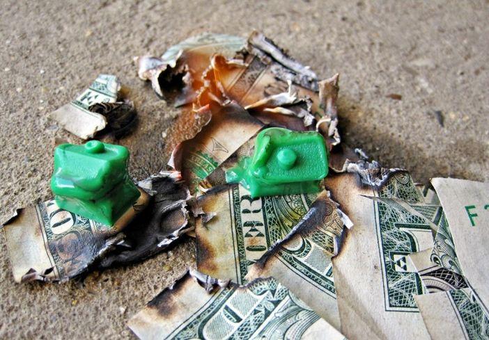 Burning house burning money